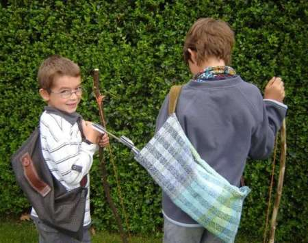 Homeschooling Boys with their bows and arrows
